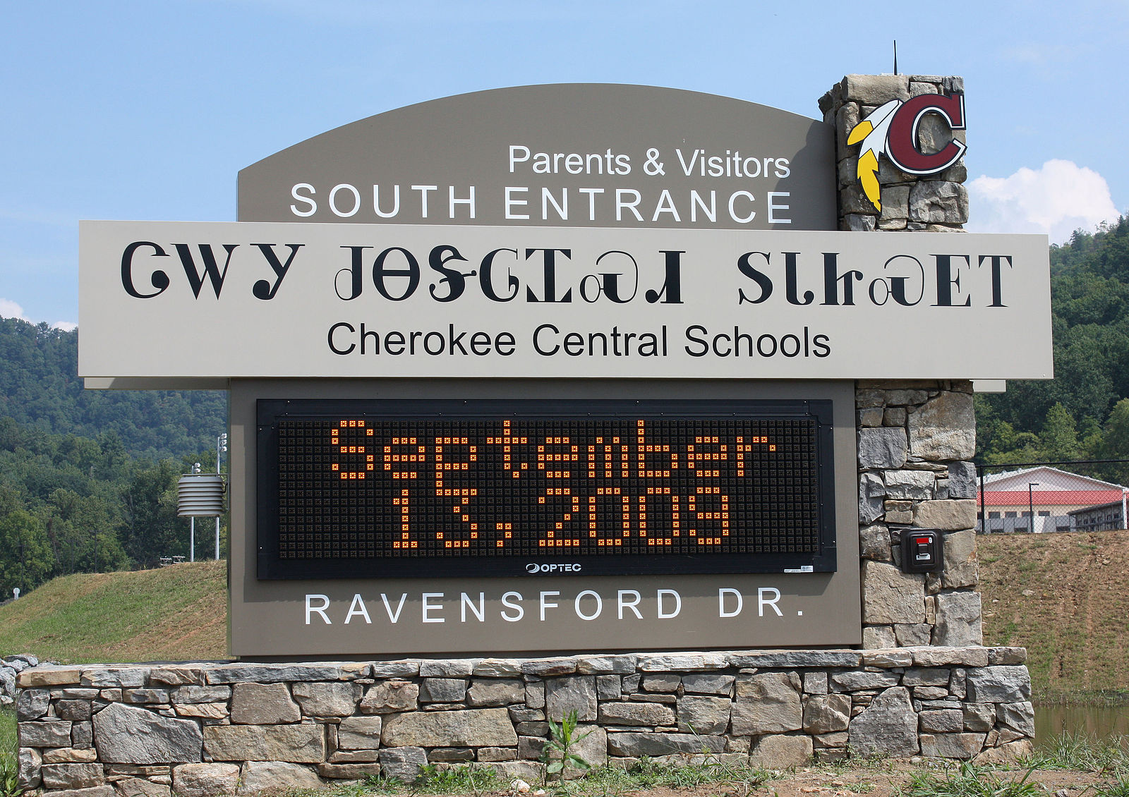 Cherokee Central Schools entrance sign written in both Cherokee and English