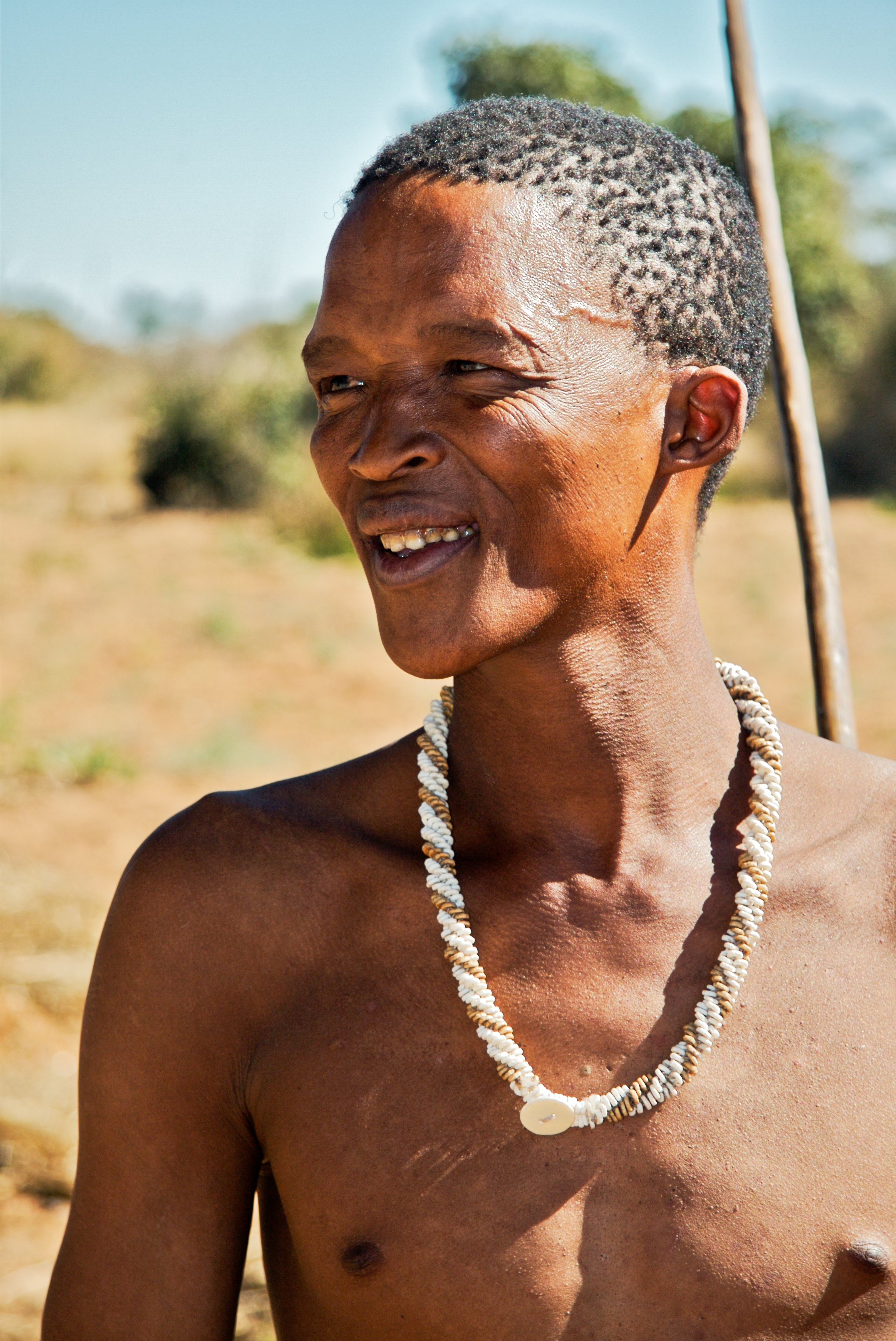 A San man wearing traditional necklace