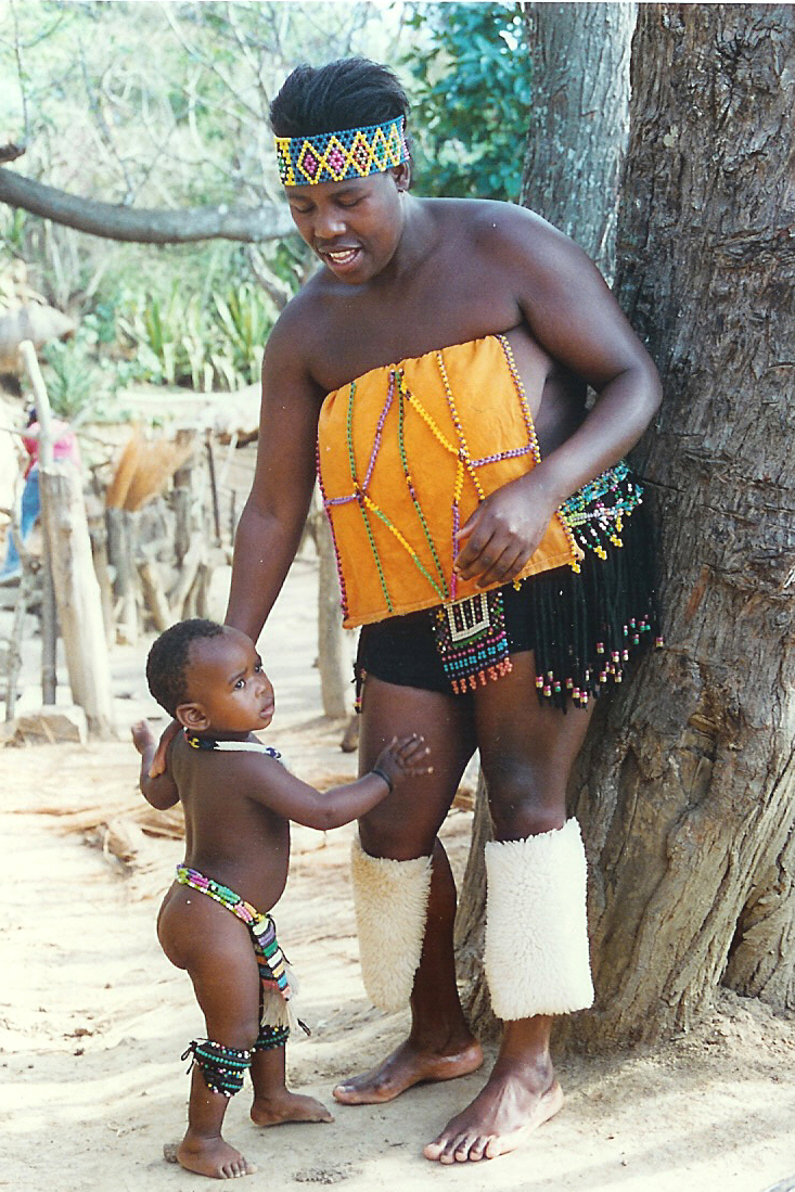 Zulu mother next ot a tree standing with a child